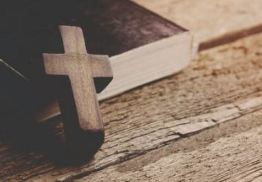 A cross against a bible